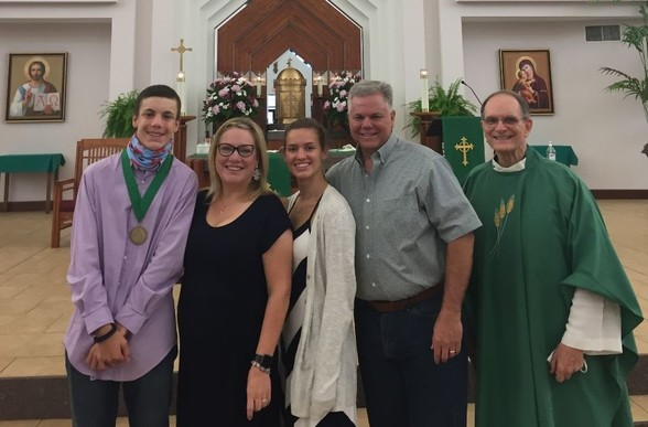 2020 St. Timothy Award Recipient, Josh Bodet, with his mother, Amy, sister, Amelia, father, Rene, and Fr. Joe.