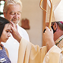 Bishop Sweeney confirms young people at St. Monica Parish in Sussex